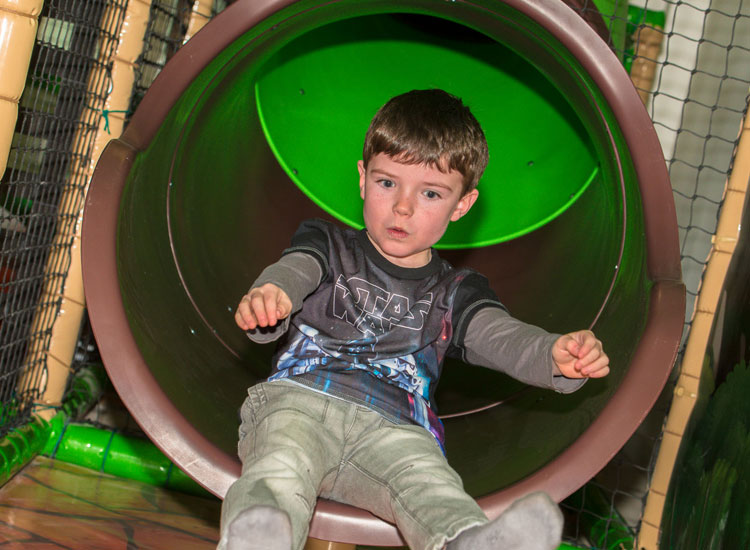 Shooting down a lide in Dino Soft Play
