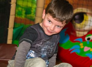 Child playing at Dino Soft Play